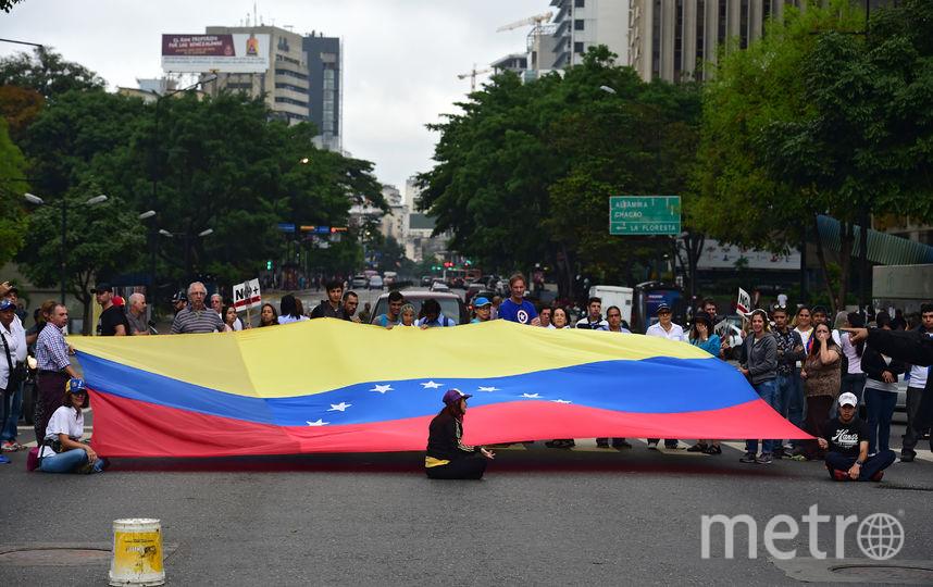 Протестующие заблокировали улицы в столице Венесуэлы. Фото AFP