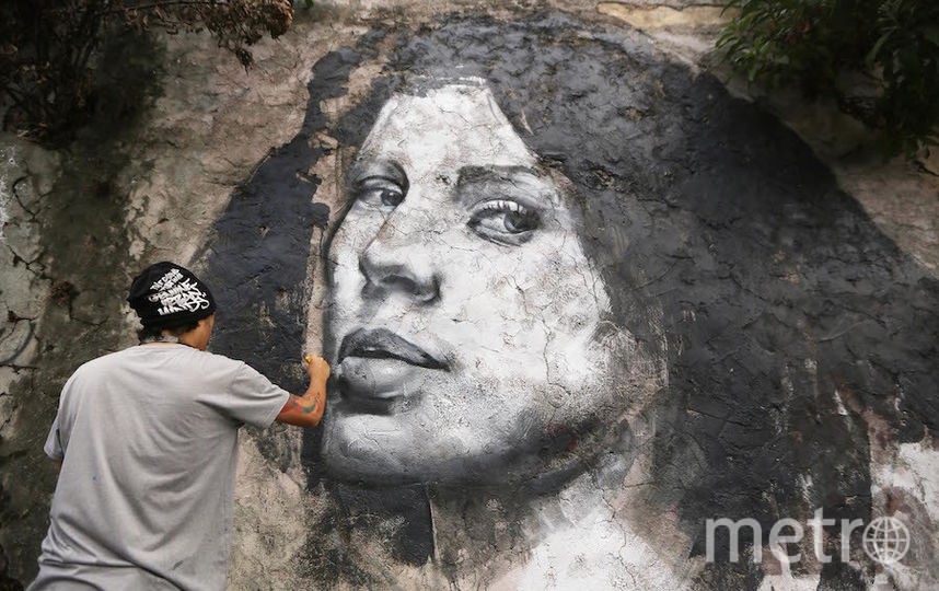 Уличные художники украшают трущобы Рио. Фото Getty