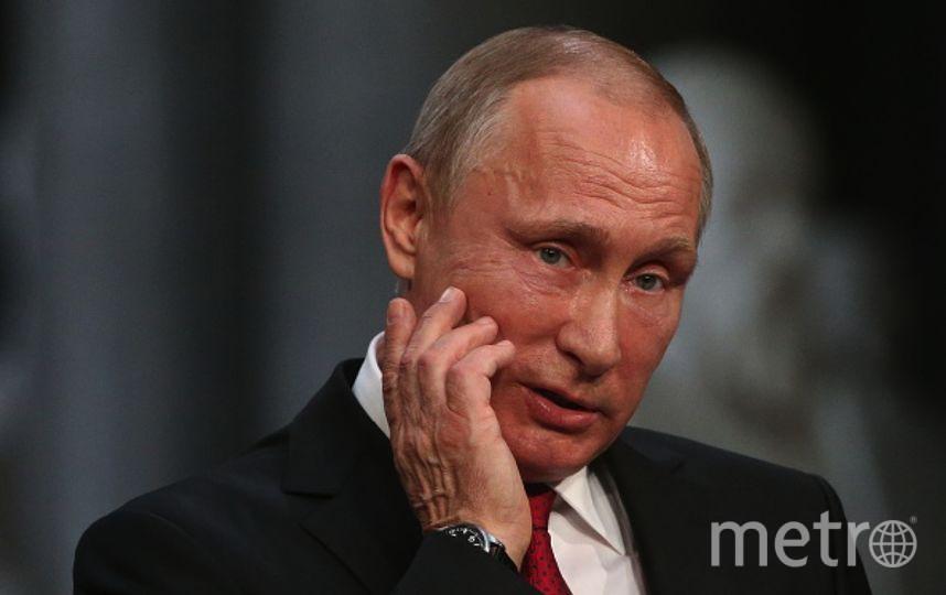 Сатирический журнал выпустил карикатуру на встречу Путина и Макрона. Фото Getty