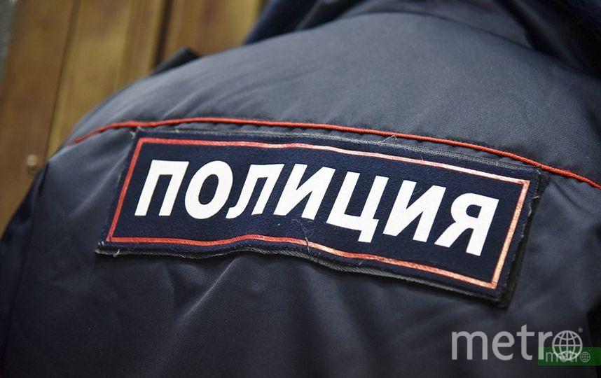 """Сотрудник полиции. Фото Василий Кузьмичёнок, """"Metro"""""""
