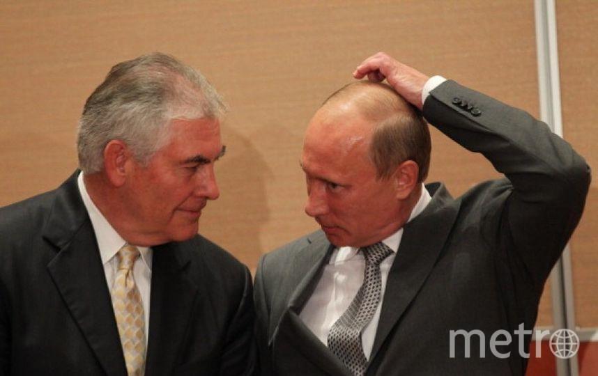Рекс Тиллерсон и Владимир Путин в 2011 году. Фото Getty