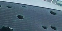 Град в Хакасии размером с яйцо побил машины и крыши: фото