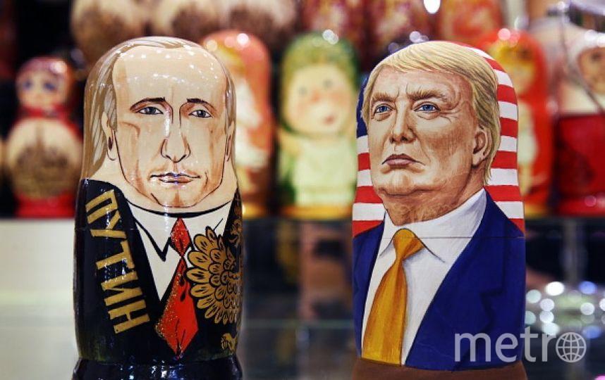 Матрёшки с изображениями Владимира Путина и Дональда Трампа. Фото Getty