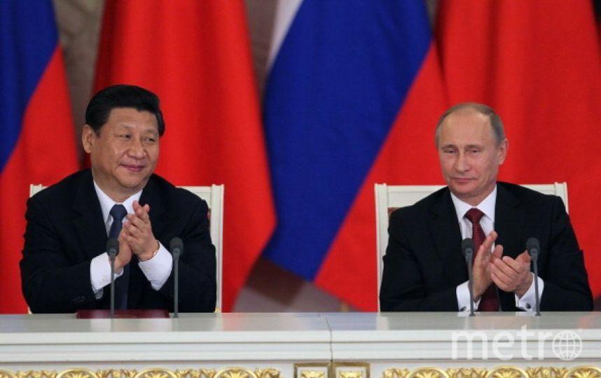 Си Цзиньпин и Владимир Путин. Фото Getty