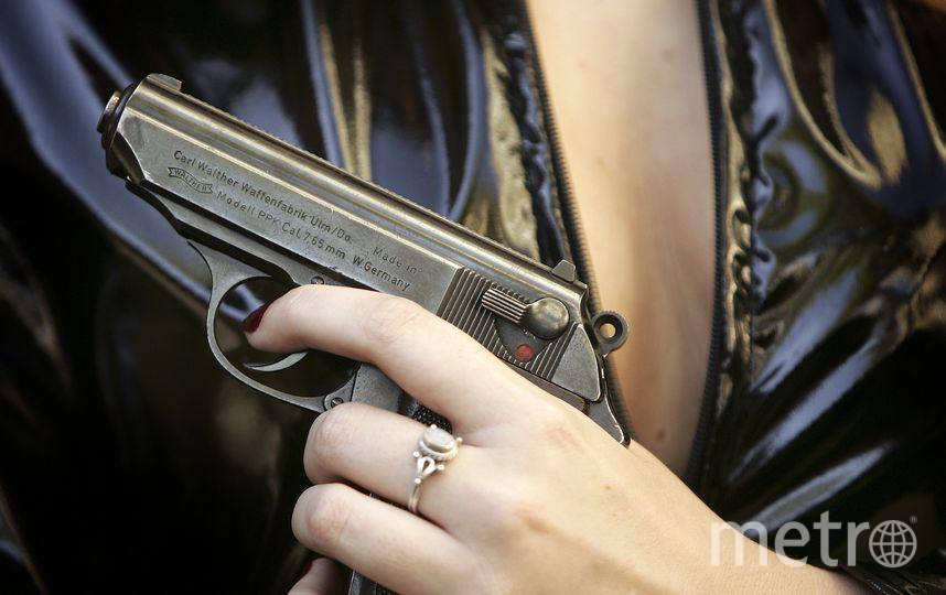 Девушка с оружием. Фото Getty