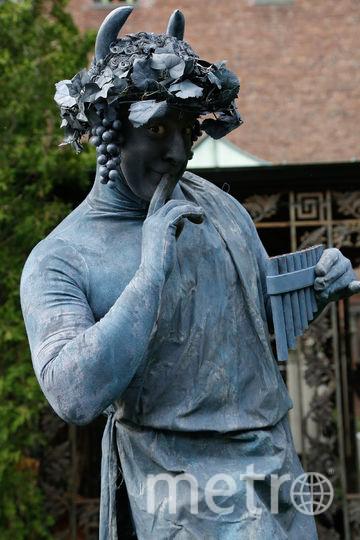 Ожившие статуи – это уличные артисты. Фото Getty