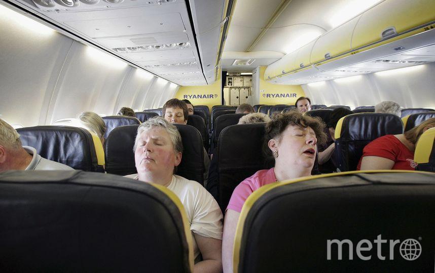 Сон в самолете. Фото Getty
