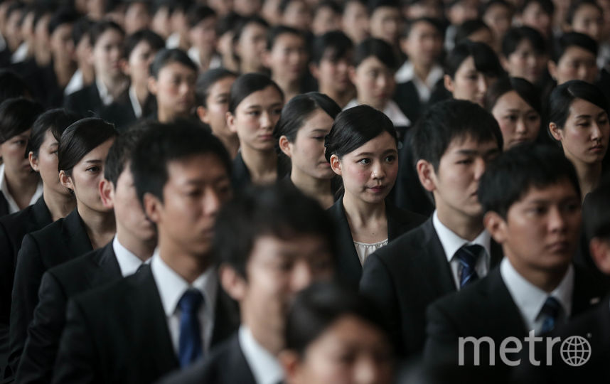 Сотрудники японской компании. Фото Getty