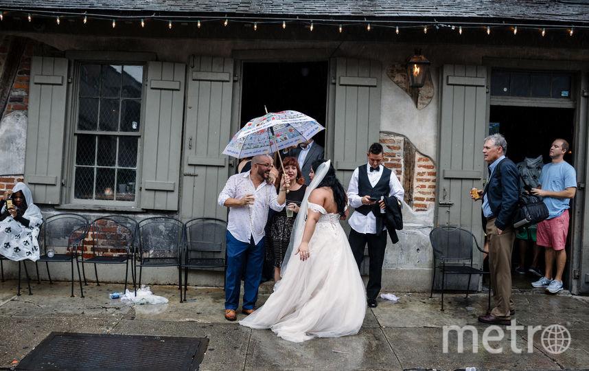Жители Нового Орлеана готовятся к удару стихии. Фото AFP