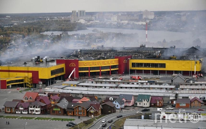 """Сгоревший рынок """"Синдика"""". Фото РИА Новости"""