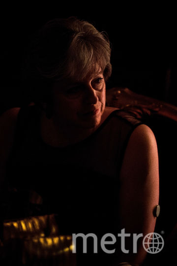 Тереза Мэй появилась на банкете в черном облегающем платье. Фото Getty