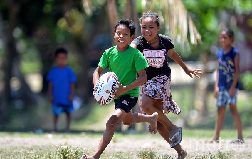 Дети, играющие в регби. Фото Getty