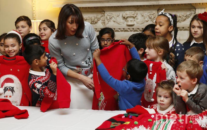 Дети в рождественских свитерах. Фото Getty