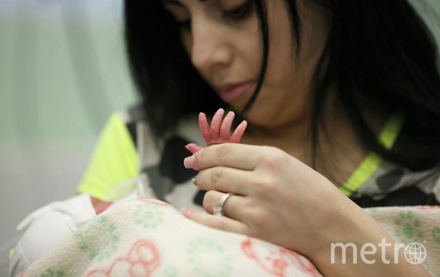 Мать с новорождённым ребёнком. Фото РИА Новости