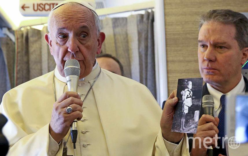Папа римский Франциск показал фотографию последствий атомной бомбардировки Нагасаки в 1945 году. Фото AFP