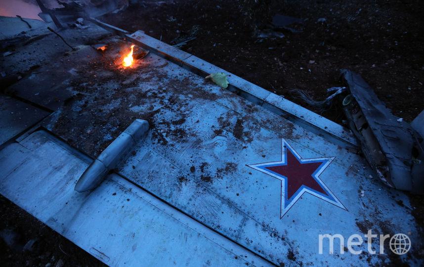 Российский штурмовик Су-25, который сбили террористы. Роман Филипов успел катапультировался, он принял бой на земле. Фото AFP