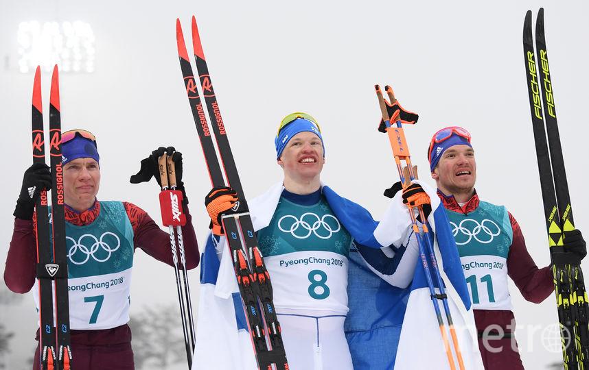 Большунов и Ларьков - на пьедестале почёта. Фото AFP