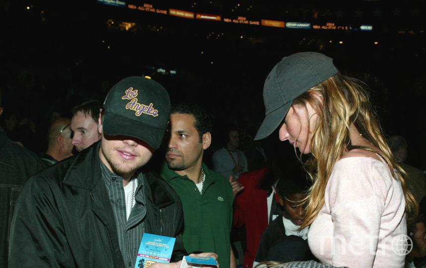 Жизель Бюндхен с Леонардо ДиКаприо в 2004 году. Фото Getty