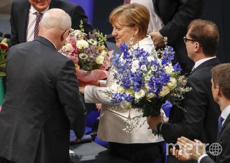 Ангела Меркель принимает поздравления. Фото AFP