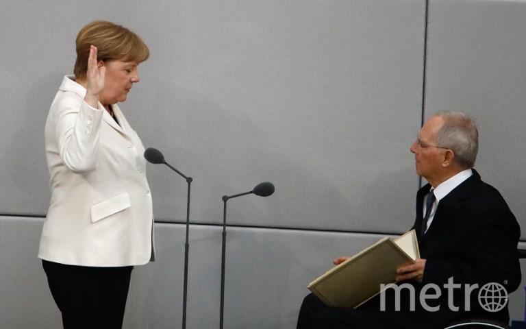 Ангела Меркель приносит присягу. Фото AFP