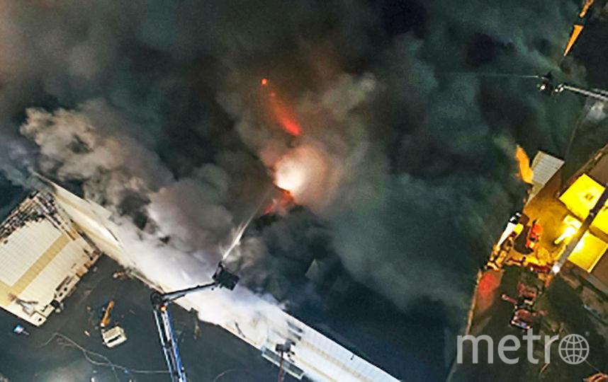 """Из-под завалов ТЦ """"Зимняя вишня"""" в Кемерово извлекли тела 58 погибших. Фото AFP"""