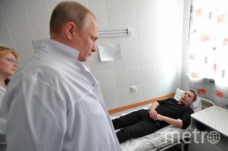"""Путин навестил пострадавших во время пожара в ТЦ """"Зимняя вишня"""" в Кемерово. Фото AFP"""