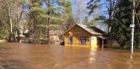 Река Сестра затопила поселок на северо-западе Петербурга. Фото и видео