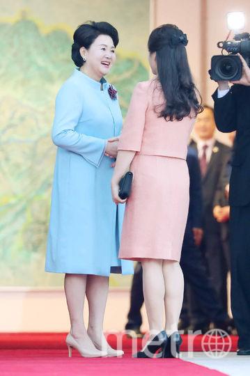 Первые леди президентов КНДР и Южной Кореи. Фото AFP