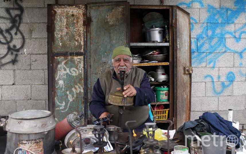 Ремонтник кухонных принадлежностей, Палестина и близлежащие территории. Фото AFP