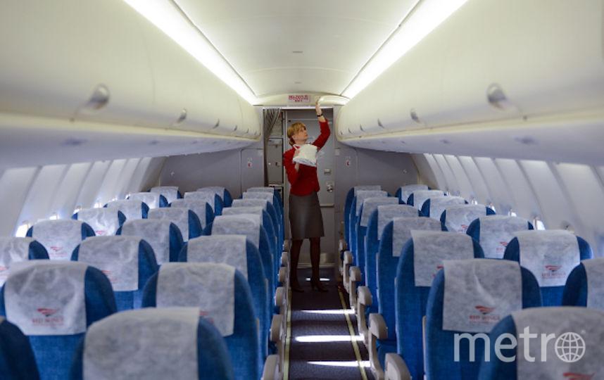 Стюардесса перед началом рейса (архивное фото). Фото РИА Новости