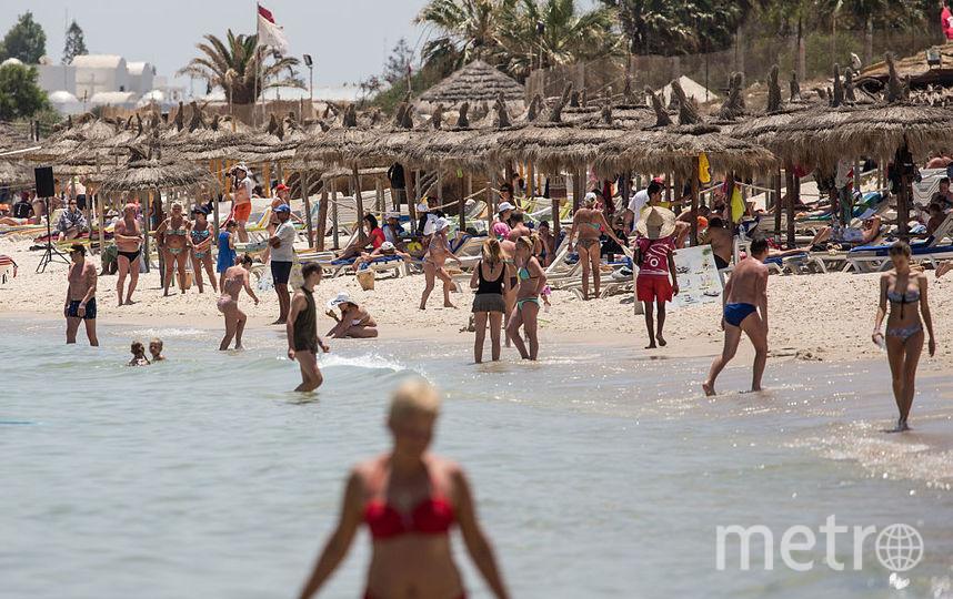 Туристы на пляже. Фото Getty