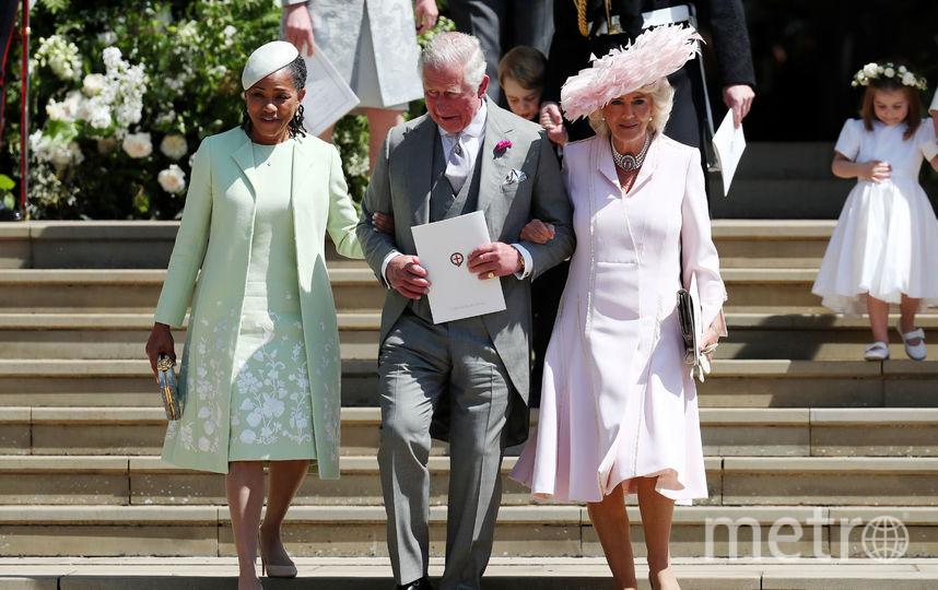 Мать Меган Маркл, Дория Рэгланд, принц Чарльз и Камилла Паркер-Боулз. Фото AFP