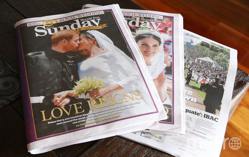 Газеты о свадьбе Меган Маркл и принца Гарри. Фото Getty