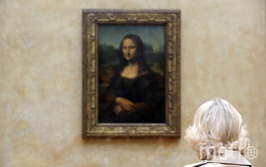 """""""Мона Лиза"""" Леонардо да Винчи в Лувре, Париж. Фото Getty"""