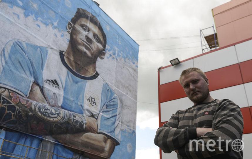 Российский художник Сергей Ерофеев нарисовал граффити с изображением аргентинского футболиста Лионеля Месси. Фото AFP