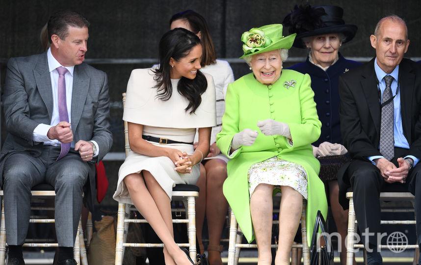 Елизавету II сопровождает Меган Маркл. Фото Getty