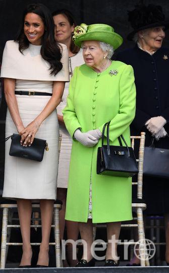 Меган Маркл впервые сопровождает королеву на официальном мероприятии. Фото Getty