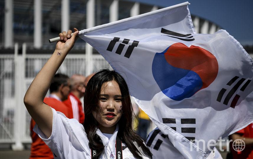 Болельщица из Южной Кореи на матче Швеция – Корея. Фото AFP