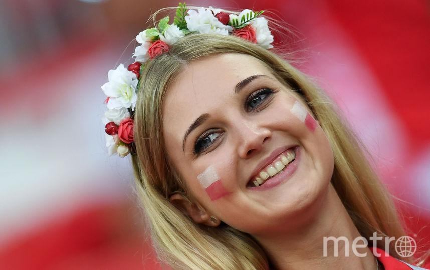 Фанатка сборной Польши. Фото AFP