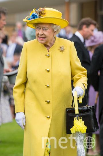 Желтый часто встречается в гардеробе королевы (май 2017). Фото Getty