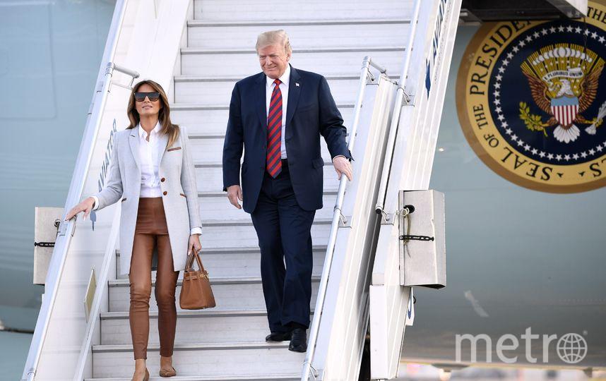 Мелания Трамп с Дрнальдом Трампом. Фото AFP