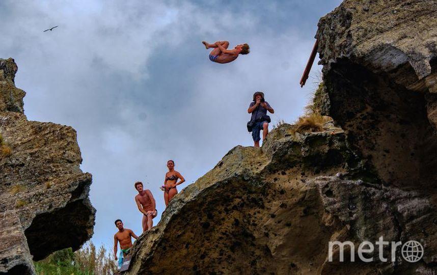 """85  км/ч – максимальная скорость, которую развивают спортсмены, прыгая со скалы во время соревнований. Фото Алена Бобрович, """"Metro"""""""