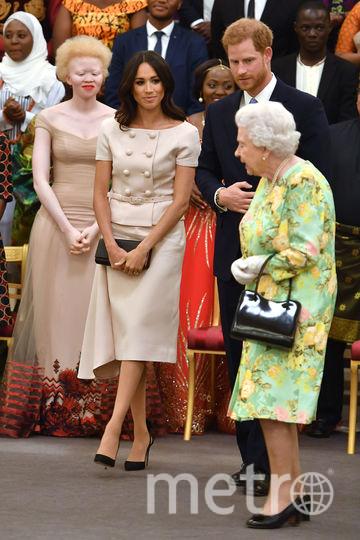 Елизавета II, принц Гарри и Меган Маркл. Фото Getty