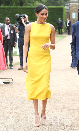 Канареечное платье Меган Маркл. Фото Getty