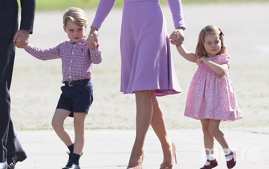 Принцесса Шарлотта с родителями. Фото Getty