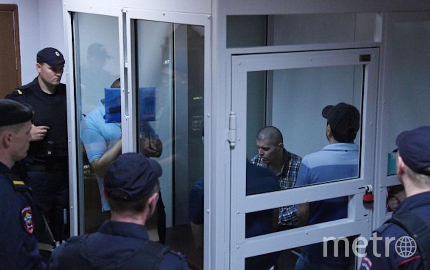 Члены банды ГТА/GTA, обвиняемые в серии убийств водителей, в Мособлсуде во время оглашения приговора. Фото РИА Новости