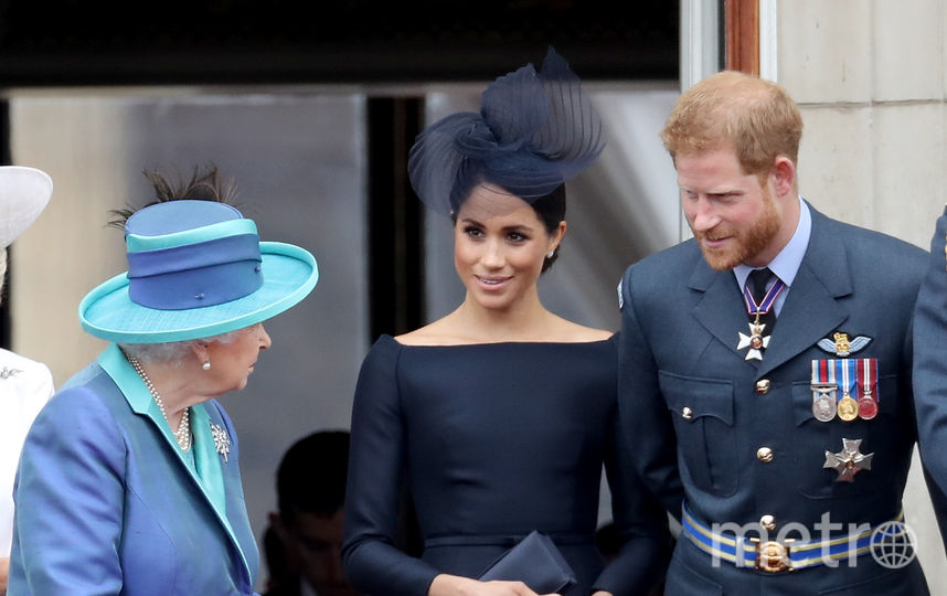 Королева Елизавета, Меган Маркл и принц Гарри. Фото Getty