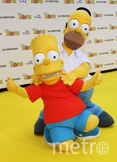 Гомер и Барт Симпсон. Фото Getty