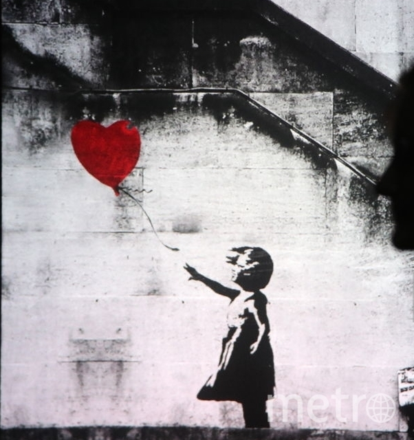 """Впервые картина """"Девочка с воздушным шаром"""" появилась в 2002 году на стене в лондонском районе Шордич. Фото Getty"""