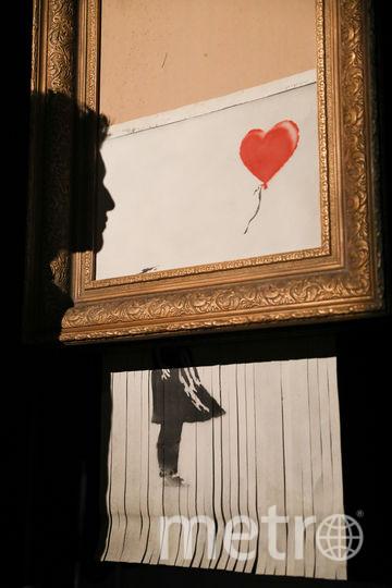 """Картина """"Девочка с воздушным шаром"""", разрезанная шредером. Фото Getty"""